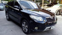 Black Hyundai Santa Fe 2012 at 67873 km for sale in Pasig