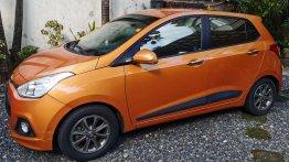 Sell Orange 2015 Hyundai Grand i10 Hatchback at 31000 km