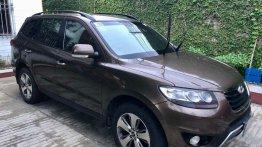 Brown Hyundai Santa Fe 2012 for sale in Manila