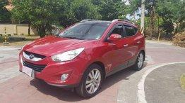 Selling Red Hyundai Tucson 2012 in Pasig